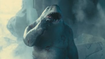king shark looks up while feasting on a snack