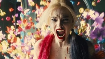 HArley Quinn screams as flowers fall around her