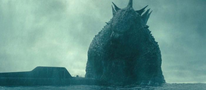 Godzilla appears next to a submarine