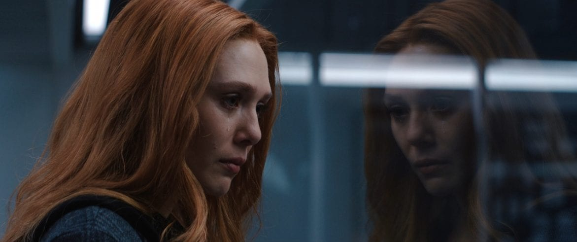 Wanda (Elizabeth Olsen) cries looking at Vision's dismantled form