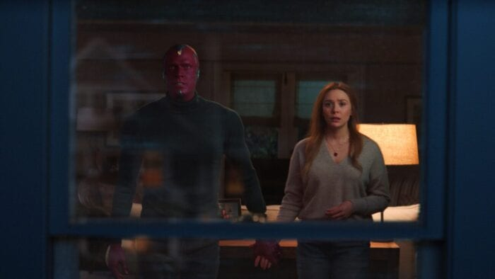 The Vision (Paul Bettany) and Wanda (Elizabeth Olsen) look out the window in WandaVision's series finale