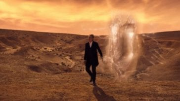 The Doctor strolls into the desert with a glowing opening behind him