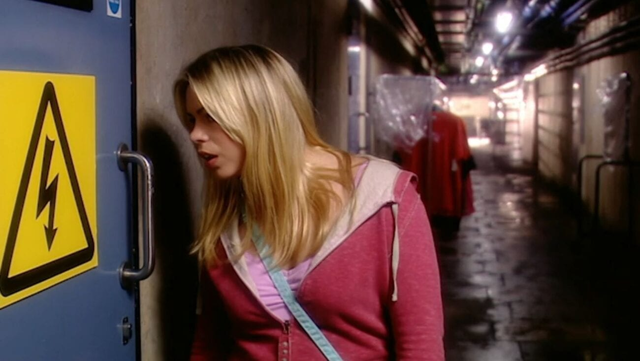 Rose leans towards a door in the basement with an electricity warning sign on it