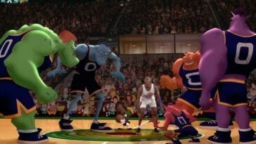 Michael Jordan stands in the middle of the Monstars during their basketball game