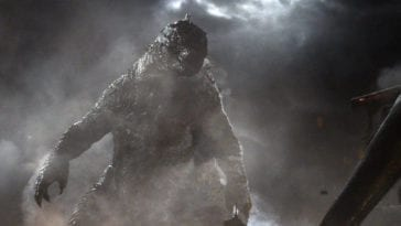 Godzilla stares down a MUTO opponent in the smoky mist.