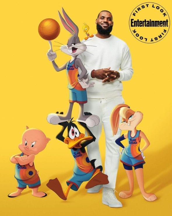 A promotional image for Space Jam: A New Legacy. LeBron James poses with Tweety Bird, Bugs Bunny, Porky Pig, Donald the Duck and Lola Bunny