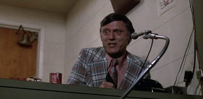 Jim Carr gives play-by-play over the radio in the media booth.