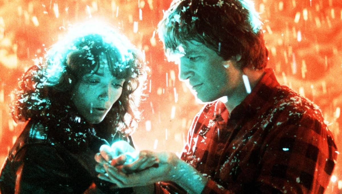 Jenny and Starman in the snow looking at his hands