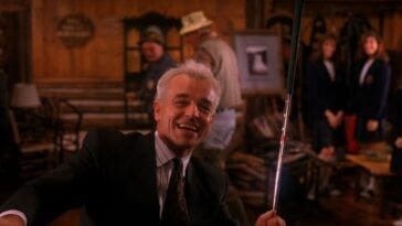 Leland smiles as he poses with a golf club he has been dancing with in Twin Peaks Episode 15