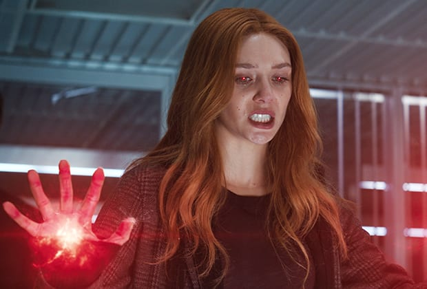 Wanda looks down in anger and prepares her powers from her right hand