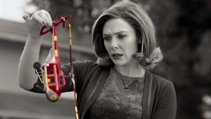 Wanda examines a toy helicopter entering her realm