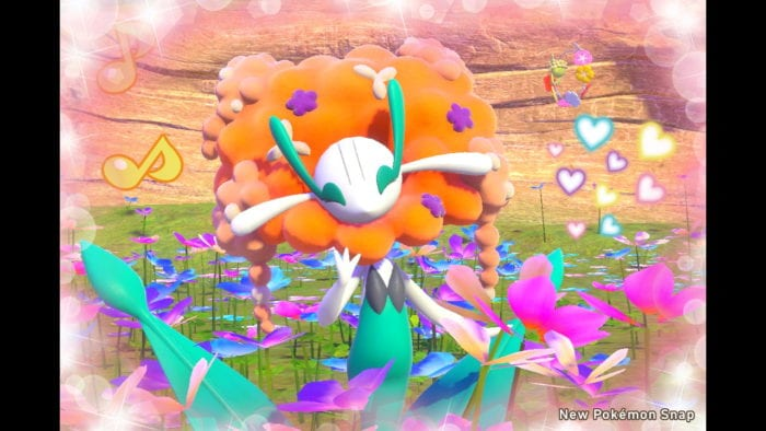 A photo of a Florgess Pokémon decorated with heart stickers