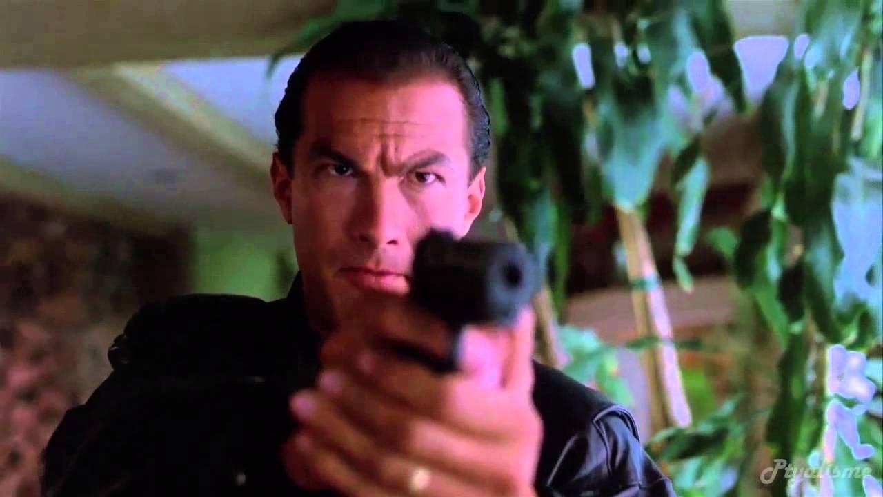Mason Storm holding his gun straight ahead