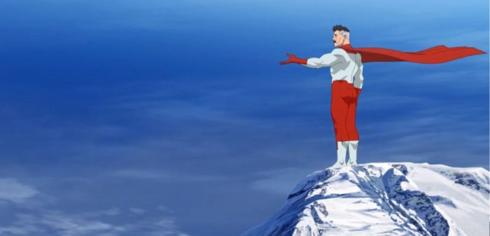 Nolan stands on the top of Mt. Everest with his arm outstretched while rehearsing what he's going to tell Mark.