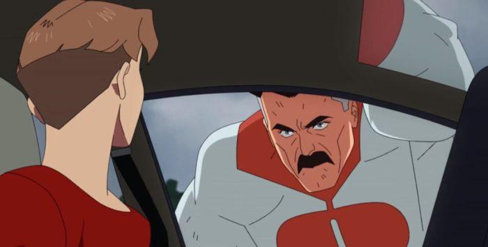 Nolan intimidates William. William is sitting in his car and Nolan looms over his window.