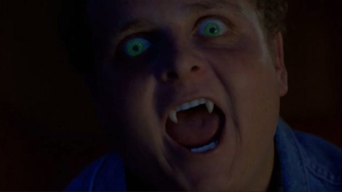 From Mulder's POV, a close-up of Ronnie starting to attack, with glowing green eyes and fangs showing