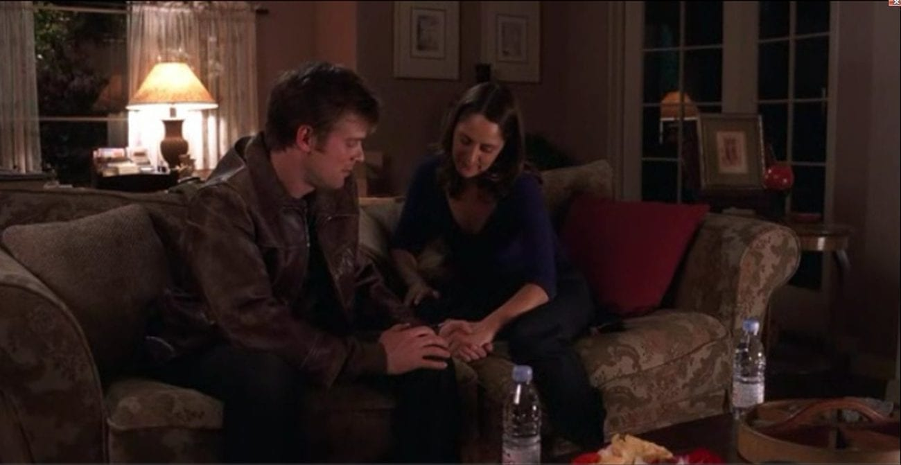 Nate and Maggie sit on a couch