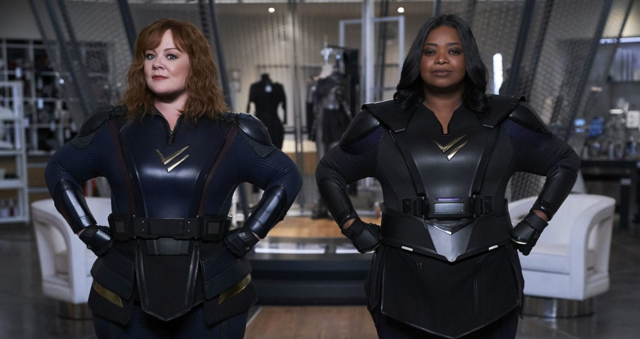 Lydia and Emily suit up and put their fists on their hips.