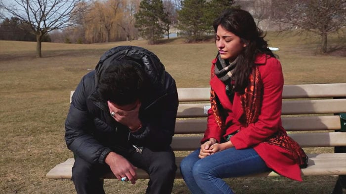 Gabriela comforts Ethan on a park bench in Toronto