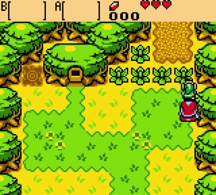 Link stands in front of a bush with Impa in Oracle of Ages