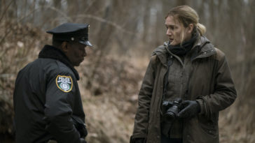 Mare Sheehan (Kate Winslet) gets filled in by Chief Carter (John Douglas Thompson) about a body that was found.