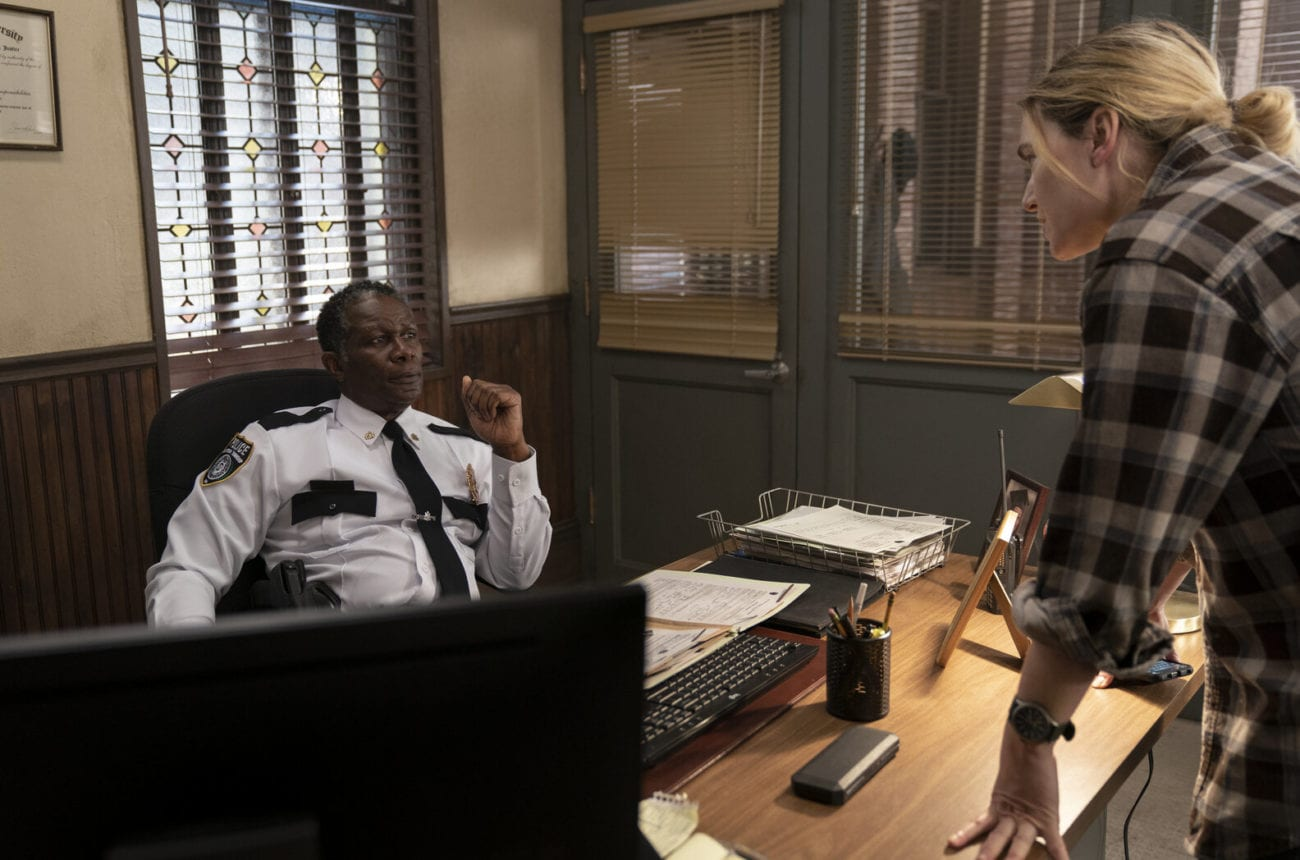 Detective Mare Sheehan (Kate Winslet) in a heated discussion with Chief Carter (John Douglas Thompson) in a scene from Mare of Easttown.