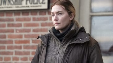 Mare Sheehan (Kate Winslet) stands outside a Police Station.