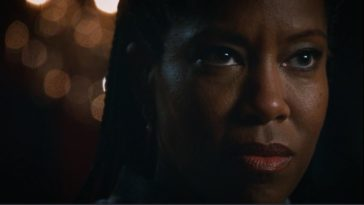 A close shot of Erika Murphy's face as she looks on stoically in The Leftovers