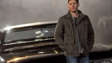 Dean leaning on Baby, with fog in the background in Supernatural