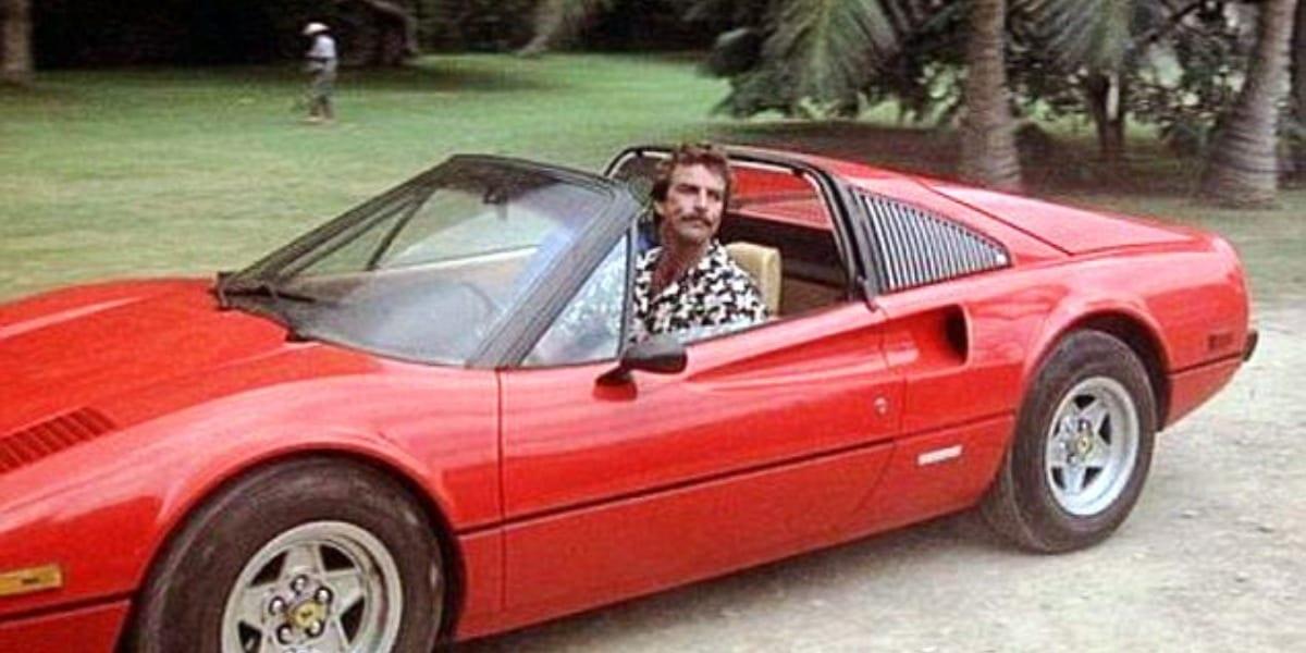 Magnum sitting in his Ferrari, smirking through the open top of the car in Magnum PI