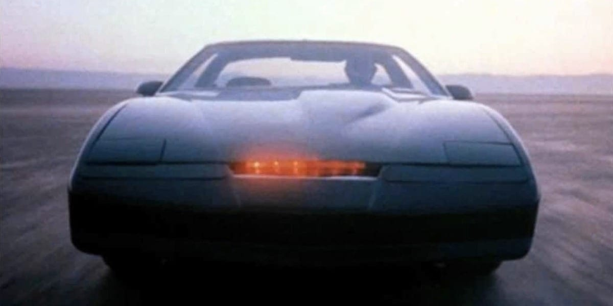 KITT driving in the desert, with Michael at the wheel of the car in the original Knight Rider