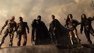 Cyborg, Flash, Batman, Superman, Wonder Woman, and Aquaman look down at their work in Zack Snyder's Justice League