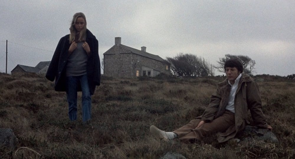 Amy (Susan George) and David Sumner (Dustin Hoffman) on the moors in Straw Dogs (1971)