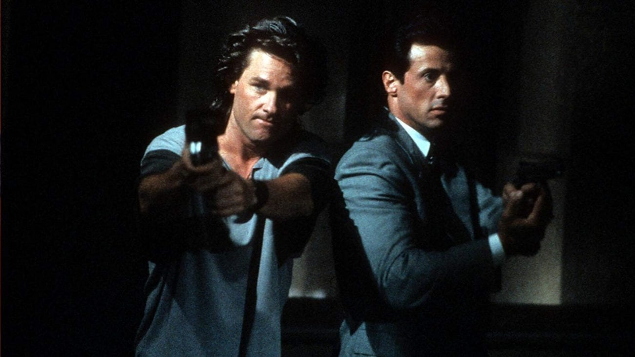 Tango and Cash standing together with guns drawn