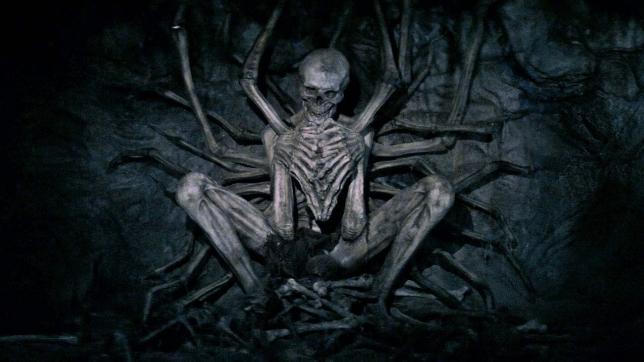 A skeleton in a squatting position against a wall in The Empty Man