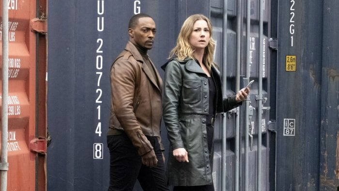 Sam and Sharon Carter (Emily VanCamp) search shipping crates...