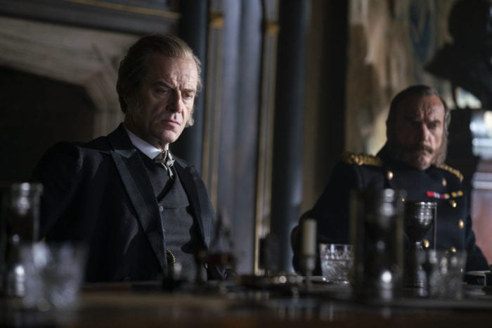 Lord Massen sits at a table looking dour in The Nevers pilot, Touched