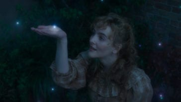 Penance Adair (Ann Skelly) reaches up a hand to be touched by a glowing speck in The Nevers