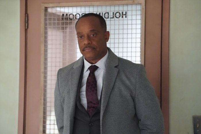 NCIS Director Leon Vance (rocky carroll) entering interrogation room