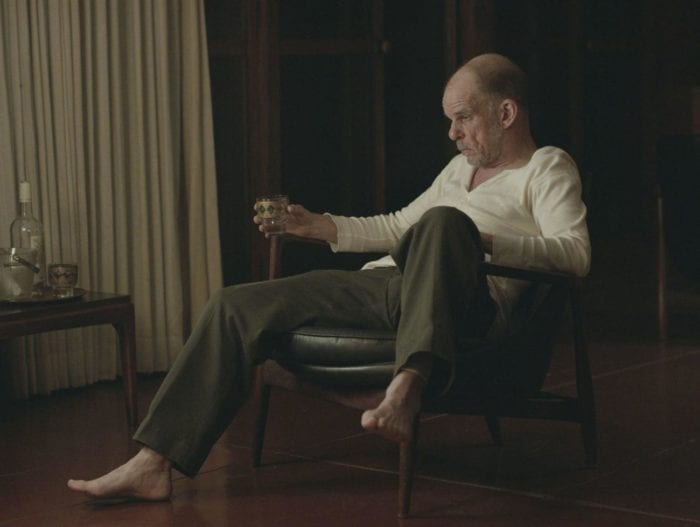 """Denis Lavant sits pensively drinking whiskey in Rick Alverson's """"The Mountain"""""""