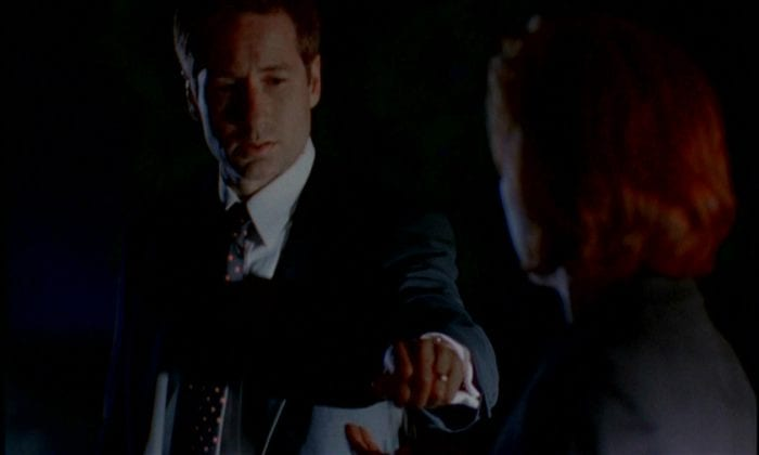 At night, Mulder drops a handful of sunflower seeds into Scully's outstretched hand