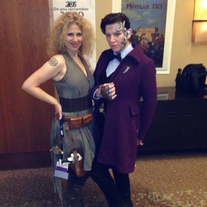 Lee as Mr. Clever and Cat as River Song posing for a photo at a convention