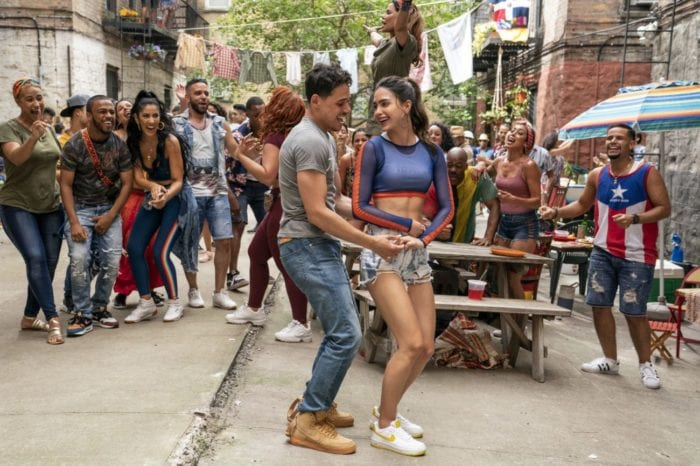 Usnavi and Vanessa dance together in front of a street crowd.
