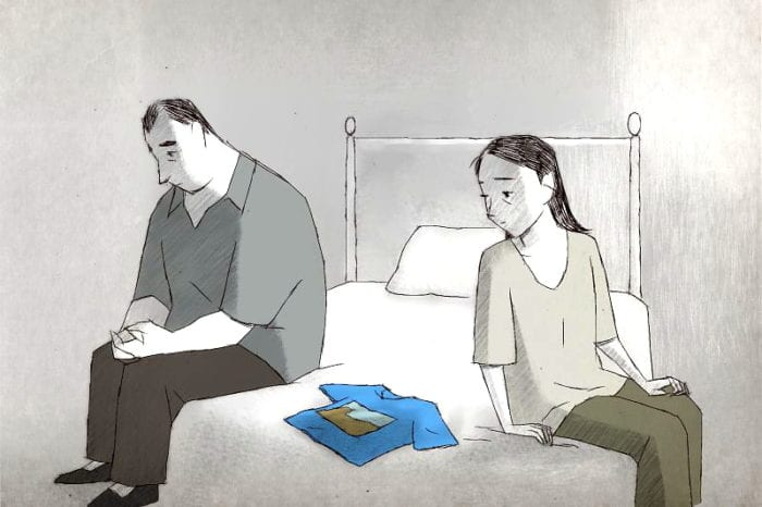 A man and a woman sit on a bed with a t-shirt in between them. The style is along the lines of a pencil drawing