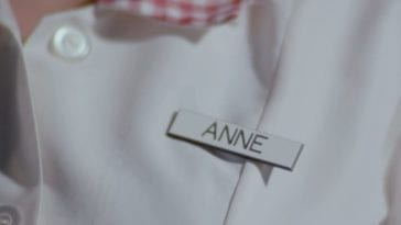 A close-up on Buffy's name badge in the Season 3 opener, reading 'Anne'