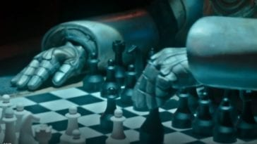 A silver Cyberman set of arms on a black and white chess table
