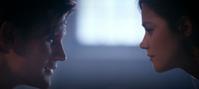 The Doctor and Clara face one another in profile