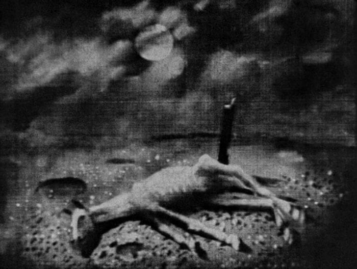 Still from A Night on Bald Mountain 1933. A dead horse lies on the ground.