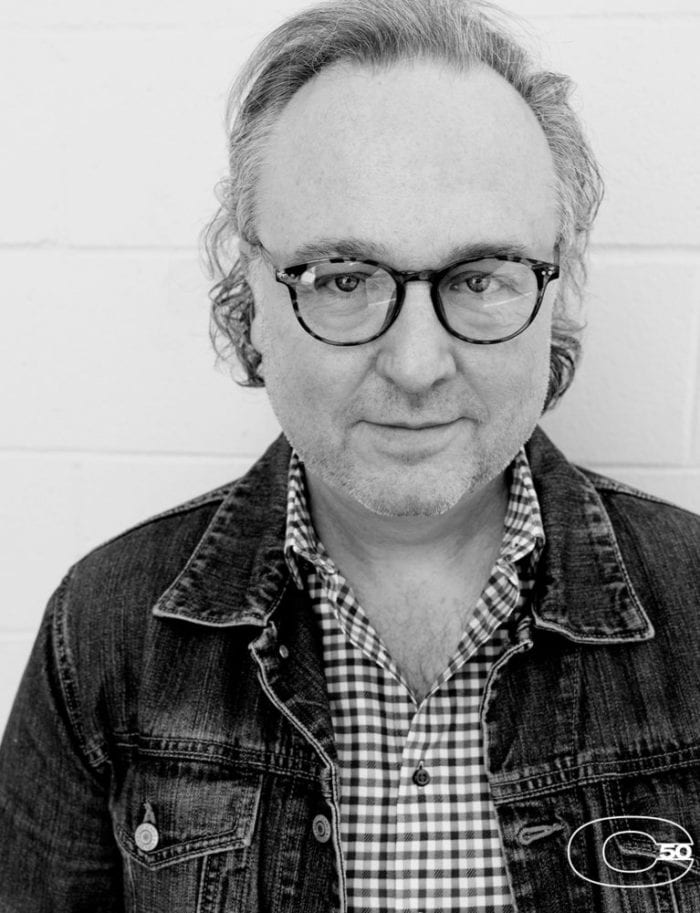 Peter Ettinger stares straight ahead for a portrait