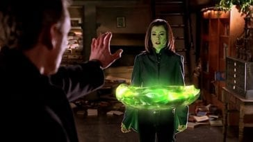 Giles holds out a hand to Dark Willow who is suspended in a ring of green magic